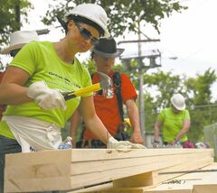 Joy Koebel puts her hammering skills to good use.