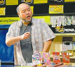 Korean store owner Paul Sun-Hyung Lee playing the part of Appa (pappa).
