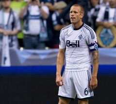 Vancouver Whitecaps captain Jay DeMerit looks on after losing 1-0 to Real Salt Lake during MLS soccer action in Vancouver, B.C., on Saturday September 28, 2013. DeMerit will announce his retirement Thursday, The Canadian Press has confirmed. THE CANADIAN PRESS/Darryl Dyck