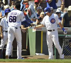 Chicago Cubs' Jorge Soler (68), celebrates with teammate Chris Valaika right, after scoring on a Welington Castillo single during the second inning of a baseball game against the Milwaukee Brewers in Chicago, Monday, Sept. 1, 2014. (AP Photo/Paul Beaty)
