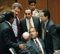 FILE - In this Sept. 28, 1995 file photo, O.J. Simpson is surrounded by his