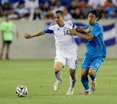 Israel's Neftali Vermouth Gil (14) is fouled by Honduras' Roger Espinoza (15) in the first half during a soccer match Sunday, June 1, 2014, in Houston. (AP Photo/Bob Levey)