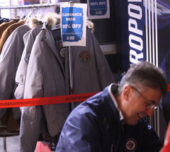 Winnipeg Jets head coach Claude Noel signing copies of the Winnipeg Free Press book The First Season Dec. 7, 2012.