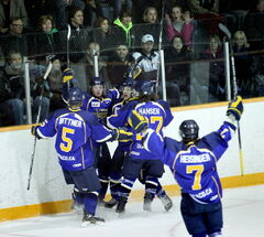 In this file photo, Steinbach fans watch in dismay as Winnipeg Blues #11 Jake Stillwell, second from left, celebrates a goal. The Blues are set to face off against the Dauphin Kings in the final.