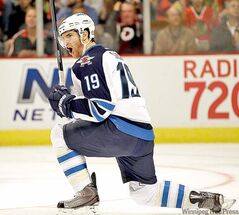 Winnipeg Jets' Jim Slater (19) celebrates his second goal during the first period of an NHL hockey game against the Chicago Blackhawks in Chicago, on Thursday, Oct. 13, 2011. (AP Photo/Nam Y. Huh)