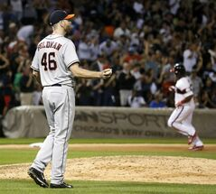Houston Astros starting pitcher Scott Feldman, left, returns to the mound after giving up a two-run home run to Chicago White Sox's Dayan Viciedo, right, also scoring Jose Abreu, during the sixth inning of a baseball game Friday, July 18, 2014, in Chicago. (AP Photo/Charles Rex Arbogast)