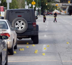 Markers lie in the street Thursday as police continue to investigate the shooting scene on Carlton Street and Graham Avenue near Tavern United.
