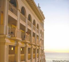 Sunset casts a pinkish orange glow on the white majesty of the Riu Pacifico Palace, along the Riviera Nayarit, north of Puerto Vallarta.