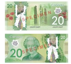 The front and back of the new Canadian $20 bill is shown in a handout photo. Thousands of vending machines still can't digest those plastic $20 bank notes.