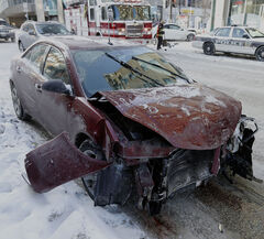 Two cars collided on Portage Avenue at Smith Street ion January, with one of the cars ending up on the sidewalk, narrowly missing a building. No one was hurt.