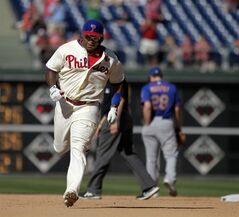 Philadelphia Phillies' Marlon Byrd runs the bases after hitting a solo home run against the New York Mets in the eleventh inning of a baseball game on Sunday, June 1, 2014, in Philadelphia. The Mets won 4-3. (AP Photo/H. Rumph Jr.)