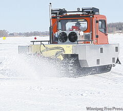Ice-cutting machine works on Red River.