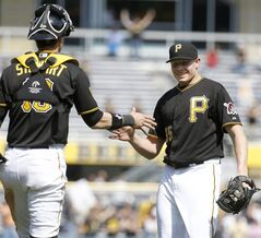 Pittsburgh Pirates relief pitcher Mark Melancon (35) is greeted by catcher Chris Stewart after getting the last out in the ninth inning of the baseball game against the San Francisco Giants on Wednesday, May 7, 2014, in Pittsburgh. The Pirates won 4-3. (AP Photo/Keith Srakocic)