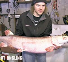 Aaron Wiebe, host of Uncut Angling, holds the musky John Selkirk caught in Lake Winnipeg.