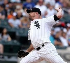 Chicago White Sox starter John Danks pitches to the Toronto Blue Jays in the first inning in a baseball game in Chicago on Saturday, Aug. 16, 2014. (AP Photo/Charles Cherney)