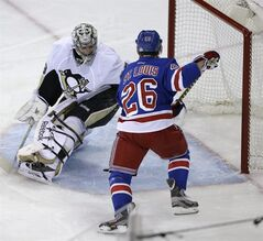 New York Rangers right wing Martin St. Louis (26) scores against Pittsburgh Penguins goalie Marc-Andre Fleury during the first period of Game 6 of a second-round NHL playoff hockey series on Sunday, May 11, 2014, in New York. (AP Photo/Seth Wenig)