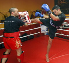 Wab Kinew trains in mixed martial arts at the Canadian Fighting Centre.