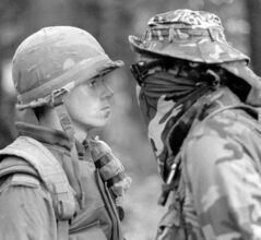 The iconic photo of soldier Patrick Cloutier and protester 'Freddy Kruger' at the 1990 Oka crisis.