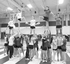 ��cole Secondaire Oak Park High School cheerleaders perform a pyramid stunt Thursday. (Photo by Wayne Glowacki / Winnipeg Free Press)