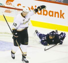 Anaheim's Corey Perry (left) celebrates after capitalizing on Zach Bogosian's giveaway Sunday night.