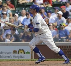 Chicago Cubs' John Baker watches his two-run double during the eighth inning of a baseball game against the Atlanta Braves in Chicago, Sunday, July 13, 2014. (AP Photo/Nam Y. Huh)