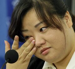FILE - This Oct. 30, 2013 file photo shows Jin hye Jo wiping a tear as she testifies during a hearing of the United Nations mandated Commission of Inquiry about the human rights situation in the Democratic People's Republic of Korea, in Washington. Her father was tortured in detention in North Korea and died. Her elder sister went searching for food during the great famine of the 1990s, only to be trafficked to China. Her two younger brothers died of starvation, one of them a baby without milk whose life ebbed away in her arms. Jin Hye Jo tearfully told her family's story Wednesday to U.N. investigators during a public hearing in Washington, their latest stop in a globe-trotting effort to probe possible crimes against humanity in North Korea. (AP Photo/Alex Brandon, File)