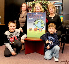 Photo by Matt Preprost Crestview School recently reached the transformational level of the province's Eco-Globe Schools program. From left to right: Grade 5 student Andrew LaMonica, vice-principal Samantha Amaral, Grade 4 student Janna De Groot, Grade 1 student Ryan Russell, and school principal Sandra Simonson.