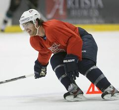 Jim Slater skates at the Iceplex this morning.