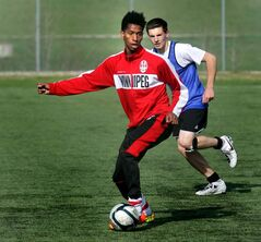Ali Musse moves the ball during a WSA team practice. His age is being questioned. Some say he is older than reported.