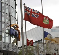 Flags fly at half-mast Tuesday outside the MTS Centre.