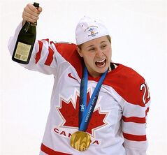 Canada's Haley Irwin hoists a bottle of champagne as she celebrates after Canada defeated the USA in women's Olympic hockey final game at Canada Hockey Place in Vancouver Feb. 25, 2010. THE CANADIAN PRESS/Scott Gardner