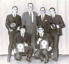 The Guess Who pose with Bob Burns and Doc Steen (back, second from right) in 1965. pose with