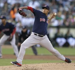Boston Red Sox pitcher Felix Doubront works against the Oakland Athletics in the first inning of a baseball game Friday, June 20, 2014, in Oakland, Calif. (AP Photo/Ben Margot)