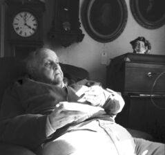 Mayor Robert Jason Hardy reclines at his antique store on the main street of Bolivar, W.Va.