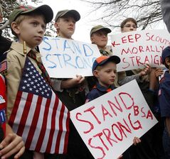 FILE - Clockwise from left, Boy Scouts Eric Kusterer, Jacob Sorah, James Sorah, Micah Brownlee and Cub Scout John Sorah hold signs at the