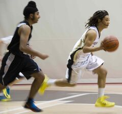 Garden City Fighting Gophers' Marcello Aruda-Welch (right) runs the ball against the Maples Marauders during the high school junior varsity boys Wesmen Classic championship final at the Duckworth Centre Friday.