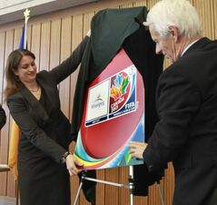 Erin Selby, Minister of Advanced Education and Literacy and FIFA representative Walter Sieber unveil the 2015 Women's World Cup logo in Winnipeg on Friday.