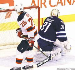 Jets goalie Ondrej Pavelec stones New Jersey�s Patrik Elias on a penalty shot in the third period.