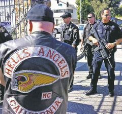 Police investigate a killing at a funeral home in San Jose, Calif., during the funeral of another Hells Angel.
