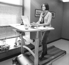 Jill Barker works at her treadmill workstation in her offices at McGill University.