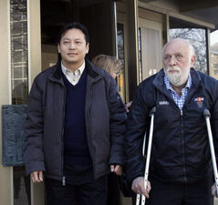 At left, Joe Chan with city councilor Harvey Smith leave the Law Courts Building. after attending the Mayor's conflict-of-interest court case today.