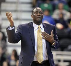 Utah Jazz head coach Tyrone Corbin gestures after a foul call in the first quarter of an NBA basketball game against the Charlotte Bobcats, Monday, Dec. 30, 2013, in Salt Lake City. (AP Photo/Gene Sweeney Jr.)