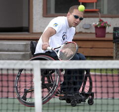 Jason Betker races to return a shot at the Deer Lodge Tennis Club Wednesday.