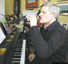 Stephen Harper relaxes with a beer and  piano music Friday at 24 Sussex Drive.