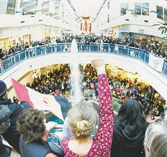 A woman raises her fist Saturday during an Idle No More flash mob at Portage Place. Will First Nations youth keep the pressure on the government next year?