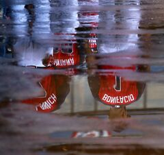 Atlanta Braves Emilio Bonifacio is reflected in puddles of water in the dugout from passing showers while the Braves and the Philadelphia Phillies take batting practice before playing in a baseball game on Tuesday, Sept. 2, 2014, in Atlanta. (AP Photo/Atlanta Journal-Constitution, Curtis Compton) MARIETTA DAILY OUT; GWINNETT DAILY POST OUT; LOCAL TELEVISION OUT; WXIA-TV OUT; WGCL-TV OUT