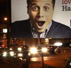 A CBS billboard faces McPhillips Street.