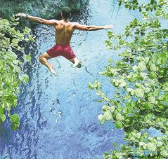 A cliff jumper in Jamaica.