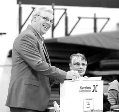 Premier Greg Selinger casts his ballot in the Oct. 4 provincial election.