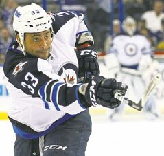 FULL CLOSE CUT CLOSECUT - Winnipeg Jets' Dustin Byfuglien follows through on a shot during the first period of an NHL hockey game against the Tampa Bay Lightning on Thursday, Feb. 2, 2012, in Tampa, Fla. (AP Photo/Mike Carlson).
